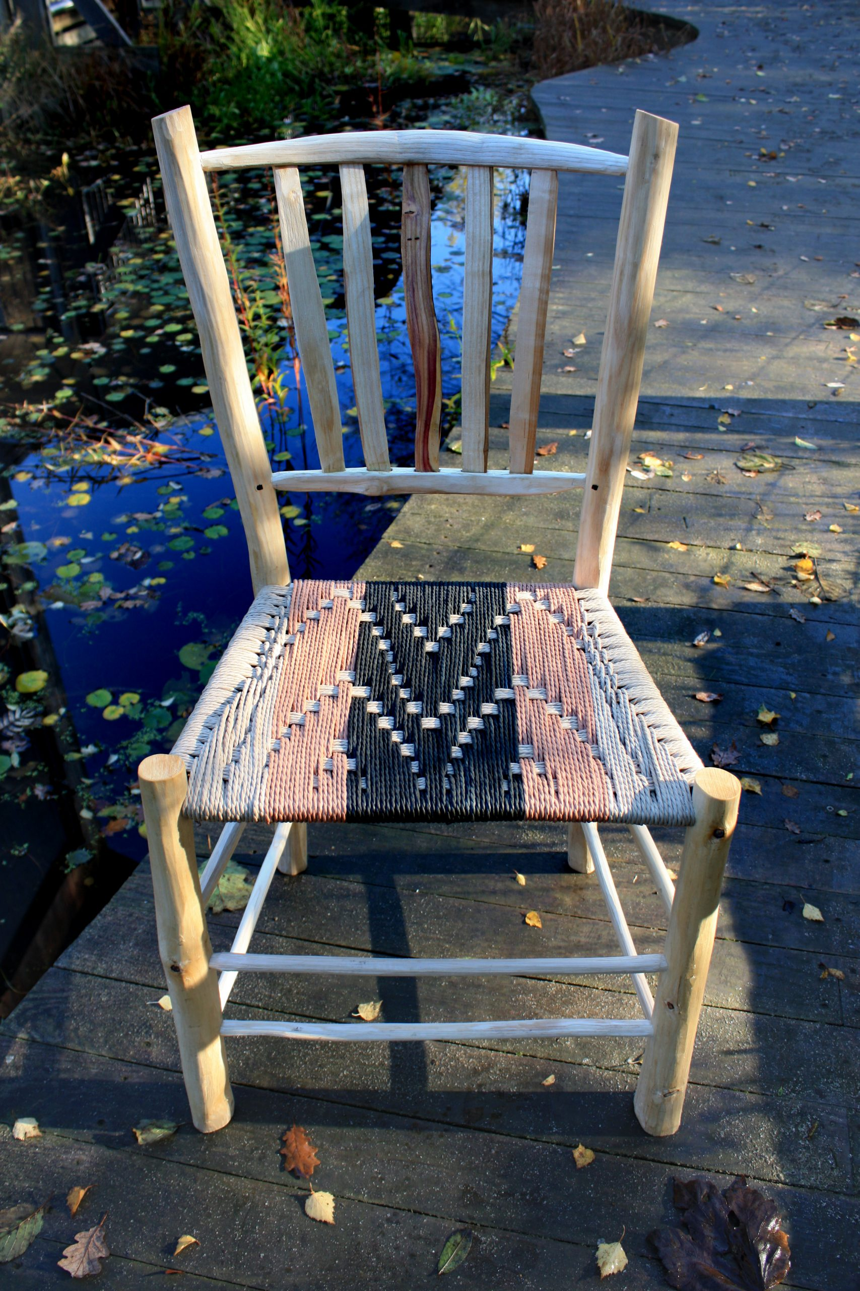 Handmade from log to chair spindle and lath back chairs made from